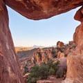 The view through the Balanced Rock. - Balanced Rock via Grapevine Hills Trail