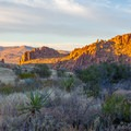 Walking down the valley at sunset as the orange hues change. - Balanced Rock via Grapevine Hills Trail