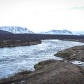 The Brúará River with scenic mountains in the background.- Brúarfoss