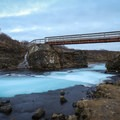 Brúarfoss gets its name from the word 'brú,' which means bridge, owing to its distant past when a natural stone bridge crossed the river.- Brúarfoss