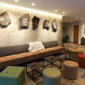 The hotel's interior includes several lounges and sitting areas with modern furnishings.- Hotel Húsafell