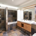 The bathroom inside a Deluxe room at the hotel.- Hotel Húsafell