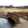 The path crosses a bridge at the site of a former mill near the hotel.- Water Trail