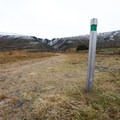Posted markers show the route as it begins to climb very slightly toward Bæjargil Canyon.- Söguhringur Trail (Follow The Old Footsteps Trail)
