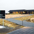 Krauma Geothermal Baths are located in a modern building in West Iceland.- Krauma Geothermal Baths