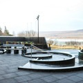 Circular hot tubs are perched with open views to the countryside and nearby mountains.- Krauma Geothermal Baths
