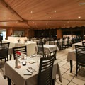 The restaurant offers fine dining options with beautiful views of the East Rangá River during the day.- Hotel Rangá