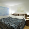 The hotel's Deluxe rooms offer king-size beds with unique art on the walls.- Hotel Rangá