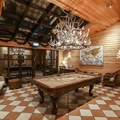 A welcoming game room offers pool, books, and board games for guest use.- Hotel Rangá