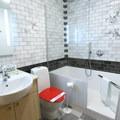 A Deluxe Room bathroom inside the Hotel Rangá with entertaining flair—a door to the bathtub!- Hotel Rangá
