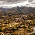 An overlook of the Colca Valley. With a depth of 3,270 meters (10,730 ft), it is one of the deepest in the world. The Colca Valley is a colorful Andean valley with pre-Inca roots and towns founded in Spanish colonial times.- Colca Canyon