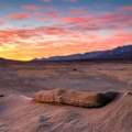 Sand formations towering above the desert floor in one of Owens Valley's colorful sunrises.- Olancha Dunes