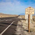 Signs along Highway 395 mark the access road to the Cottonwood Creek Charcoal Kilns.- Cottonwood Creek Charcoal Kilns