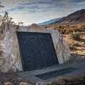 A historical plaque placed by the Clampers sits near Highway 395 along the dirt access road.- Cottonwood Creek Charcoal Kilns