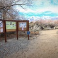 An info sign marks the way.- Eastern California Museum Trail