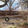 The Dehy Park trailhead is at a footbridge across Independence Creek at the back of the park.- Eastern California Museum Trail