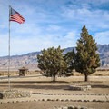 A flag flies over the internment camp where American citizens and immigrants of Japanese descent were rounded up and forced to live because of their ethnicity.- Manzanar National Historic Site
