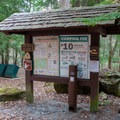 Registration sign and pay station.- Horse Cove Campground
