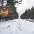 A trail sign on Route 9.- Poke-O-Moonshine Snowshoe