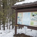 The trail map and kiosk at the parking area.- Poke-O-Moonshine Snowshoe
