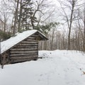 A lean-to at the trail junction.- Poke-O-Moonshine Snowshoe