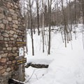 The remains of the ranger cabin.- Poke-O-Moonshine Snowshoe