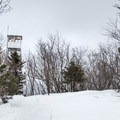 Sight of the fire tower.- Poke-O-Moonshine Snowshoe