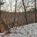 A view of the Genesee River through the winter trees.- Genesee Riverway Trail at Seneca Park