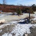 Turn from Loop Road onto Verkeerder Falls Trail.- Sam's Point Loop