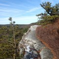 High Point Trail travels along the edge of several cliffs.- Sam's Point Loop