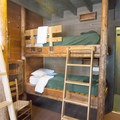 There are four bunks to a room.- Adirondack Loj