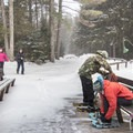 Strapping in for the trail.- Adirondack Loj