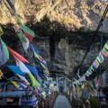 Several times a day, trekkers cross metal suspension bridges covered in prayer flags.- Annapurna Circuit
