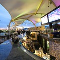 A bar offers guests a menu of cocktails to enjoy while at the rink.- Ice Rink at the Grand Sierra Resort