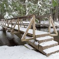 The footbridge that connects the Stewardship Trail and the Trapper's Trail around Round Lake.- Stewardship Trail