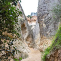 The walls of the canyon quickly grow narrow on Annie's Canyon Trail.- Annie's Canyon Trail via North Rios Trail