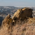 Large rocks are rare in this area, where most of the features are of water-carved soil.- Bennett-Cottonwood Loop via Maah Daah Hey Trail