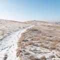 Incredible views lie just beyond the snowy plain.- Bennett-Cottonwood Loop via Maah Daah Hey Trail