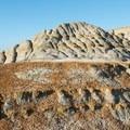 Orange soil and rock adds color to the terrain.- Bennett-Cottonwood Loop via Maah Daah Hey Trail