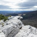 The jagged edge of the crag is picturesque, set against the Hudson Valley.- Bonticou Crag and Table Rocks