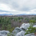 A viewpoint along the trail to Table Rocks overlooks the Catskills.- Bonticou Crag and Table Rocks