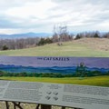 An interpretive sign describing the Catskill Mountains from inside the pavillion.- Bonticou Crag and Table Rocks