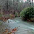 The Tallulah River flowing around a bend after heavy rainfall.- Tallulah River Campground