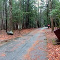 Entrance road to Tallulah River Campground with the bear-proof trash receptacles. - Tallulah River Campground