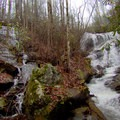 Upper Denton Creek Falls on the right with an unnamed tributary tumbling down on the left.- Denton Creek Falls Trail