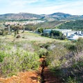 A panoramic view of the San Marcos suburbs and Rancho La Costa Habitat Conservation Area.- Copper Creek Trail via Whiptail Trail