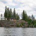 Esnagi Lodge perched on a bluff overlooking the lake.- Lake Esnagi Fishing Lodge