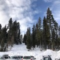 """The parking area at Brundage Mountain Resort. The north end of the parking lot has a large """"dog area"""" sign. Ski up through that to hit the road and take a right.- Brundage Mountain (Sargeant's Peak)"""