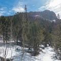 Nearing the lower saddle. Twin Sisters Peak.- Twin Sisters Peak