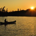 Canoeing and fishing near sunset in the Boundary Waters Canoe Area Wilderness.- Mining Endangers Minnesota's Boundary Waters